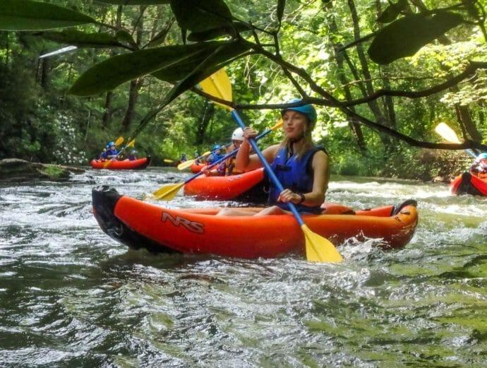 Pioneers kayaking on a river