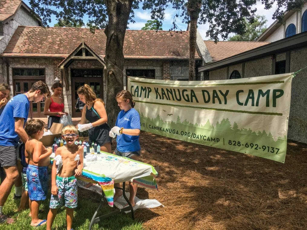 Leadership Academy teens helping campers at Camp Kanuga Day