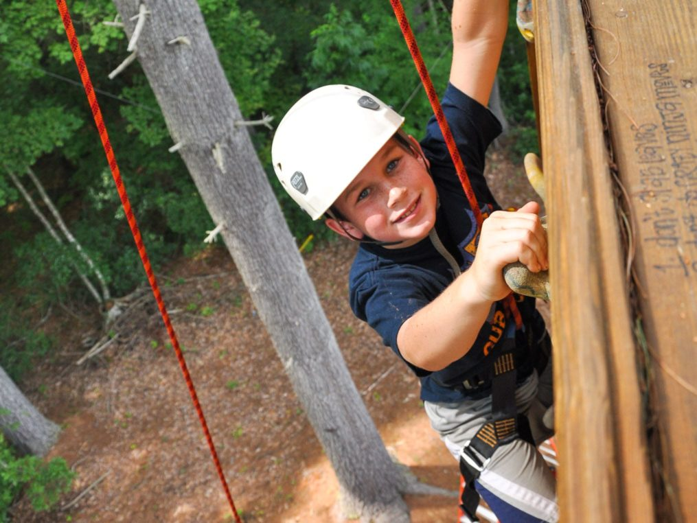Young male climber on the rock tower on the Rock Climbing & Canoeing Pioneer Expedition