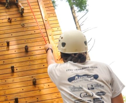 Staff belaying a climber on the Rock Climbing & Canoeing Pioneer Expedition
