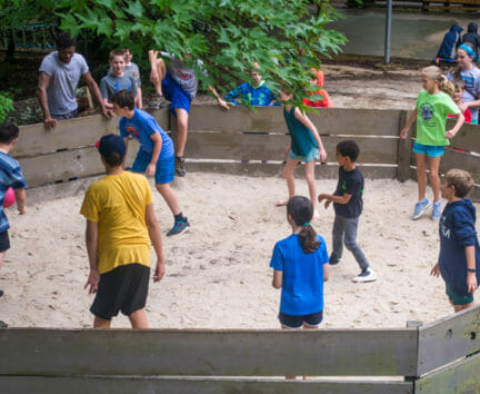 Boys playing a game of ga ga at camp