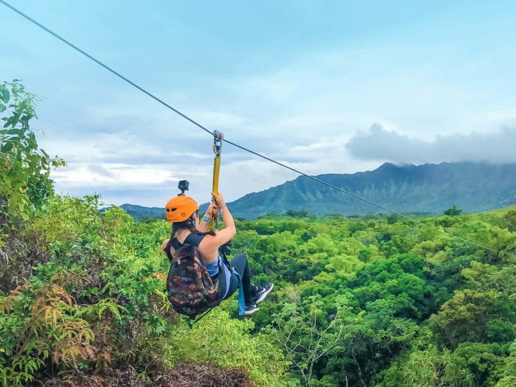 Camper on a zip line in Hawaii
