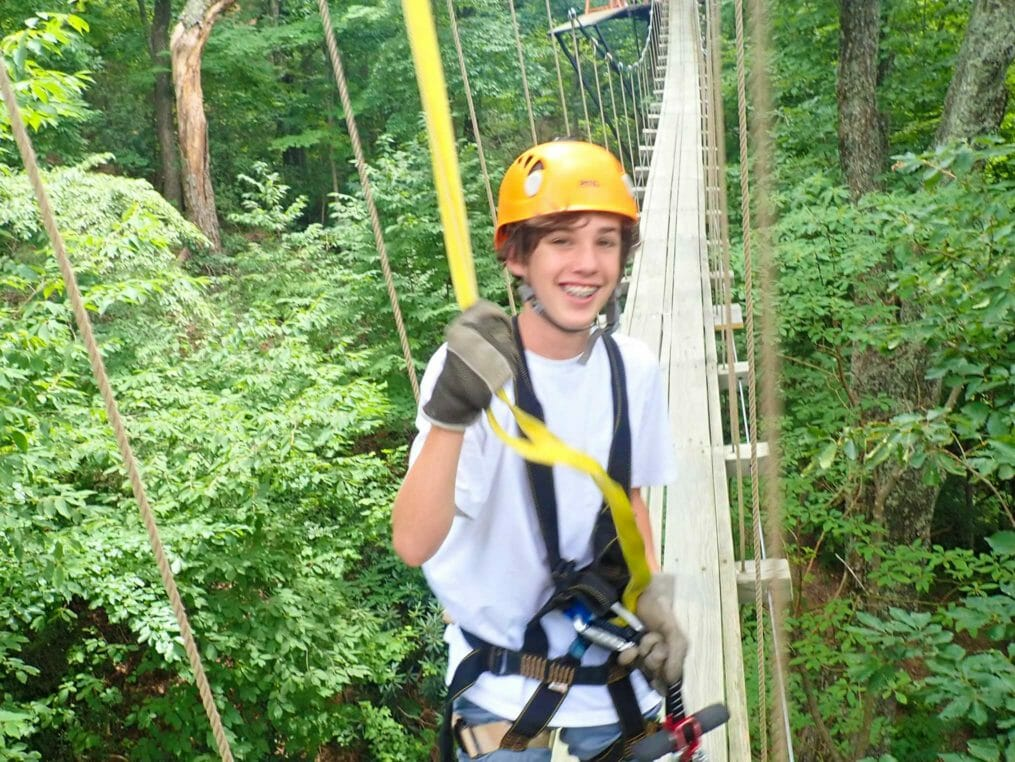 Camper on the ropes course at the Hendersonville Adventure Day Camp