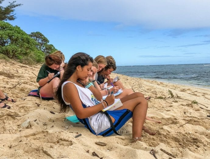 Girls on the Hawaii expedition trip writing