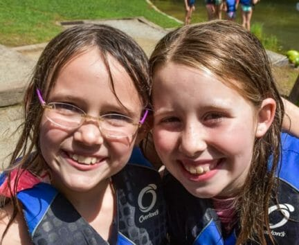 Two girls wearing life jackets at the Hendersonville Adventure Day Camp