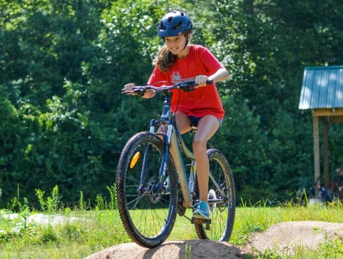 Girl mountain biking at camp