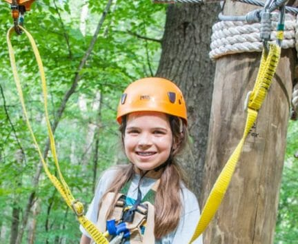 Female camper about to zip line