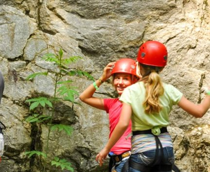 Two young female climbers talking on the Rock Climbing & Canoeing Pioneer Expedition