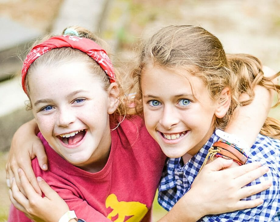 Two girls hugging at day camp