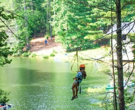 Camper zip lining at the Hendersonville Adventure Day Camp