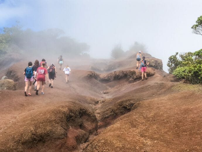 Campers hiking a foggy area of Hawaii on an Expedition trip