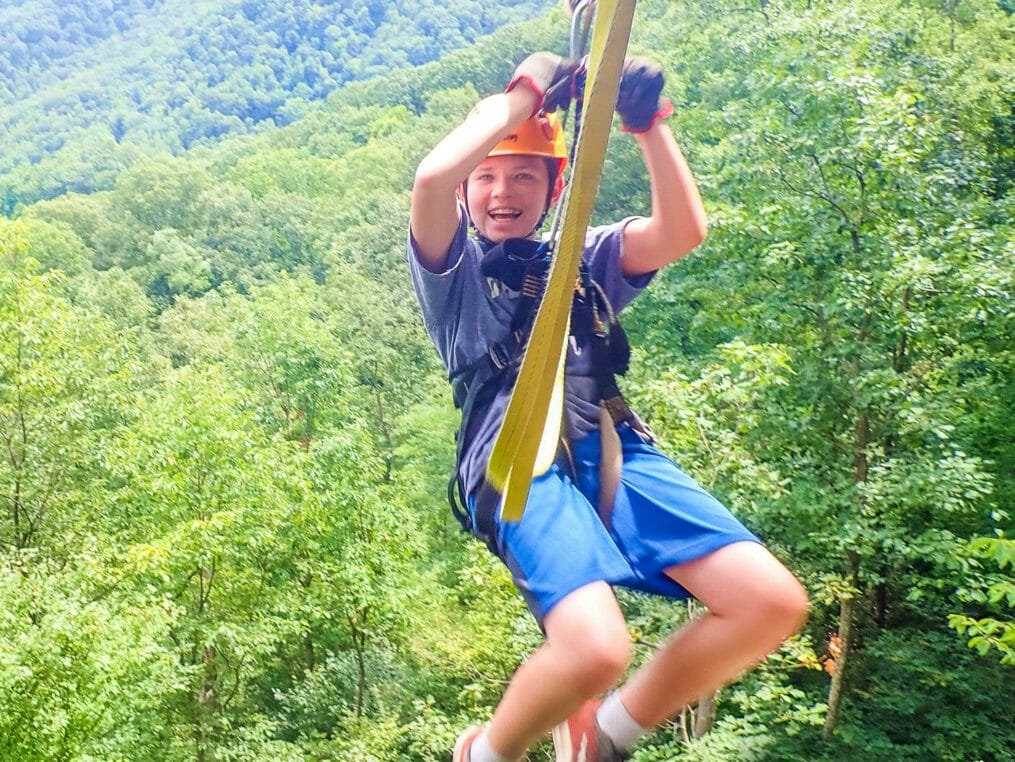 Boy on the zip line smiling