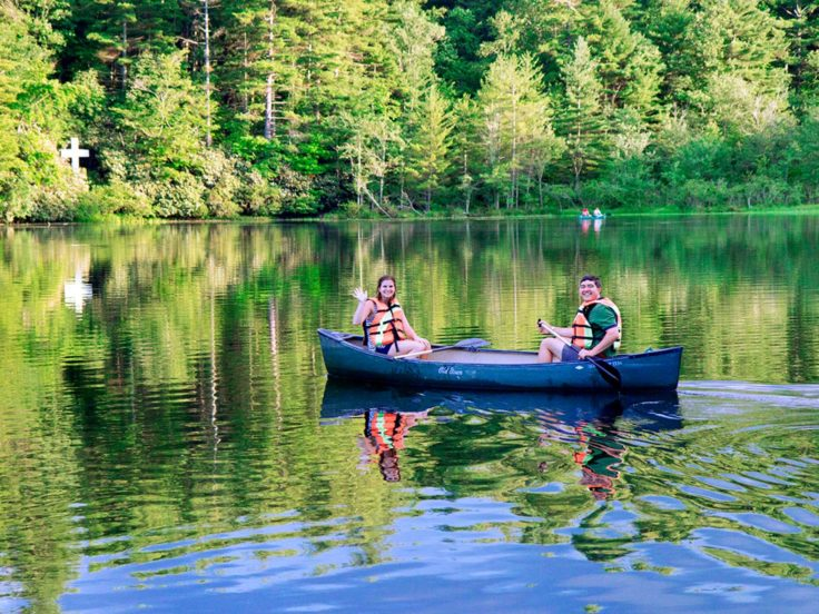 Two women at Adult Camp canoeing