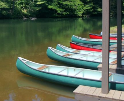 Canoes on lake at Adult Camp